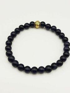 Blauwe goudsteen armband met goudkleurige sluitkraal